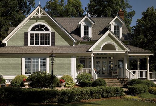 Vinyl siding polymer shakes paint the decorative accent for Cypress color vinyl siding