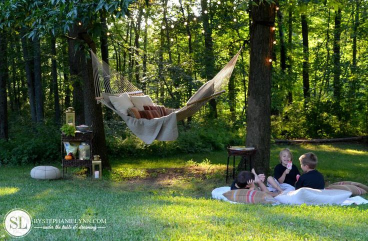 I just love hammocks!  Great idea to put white lights above the hammock for beauty at night.  AND I often forget that bringing covers and cute outdoor pillows make it so much more comfortable!