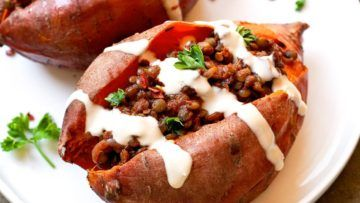 Baked sweet potatoes filled with tasty barbecue lentils with tahini sauce. This wonderful dish is super simple to make, healthy and packed with flavor! #vegan #recipes #veganfood #stuffed #sweetpotatoes #dinner