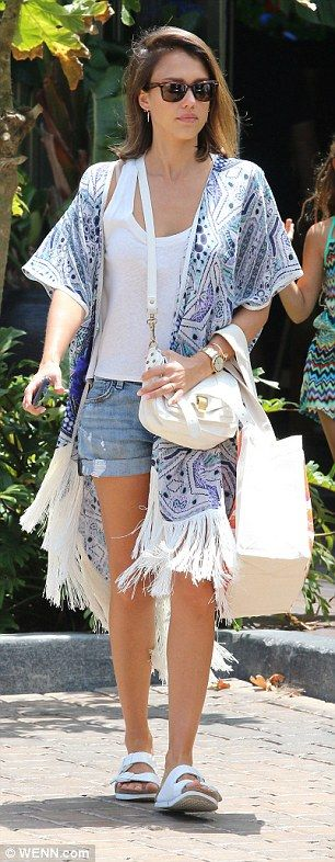 Relaxed style:For their lunch, Jessica wore a more beachy look of denim shorts with a white tank and a striking fringed kimono