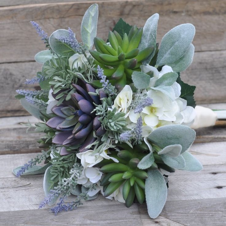 Succulents, lavender, lambs ear and hydrangea in this silk flower bouquet by Holly's Wedding Flowers.