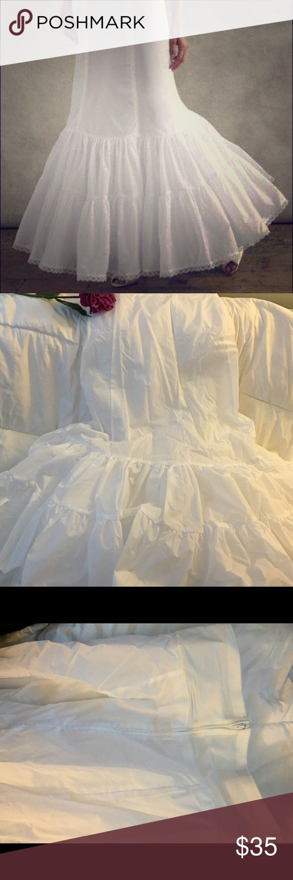 Davids bridal Fit and Flare Slip Size 14 Fit and Flare Wedding dress slip size 14, but in reality fits a 10/12, my dress was a size 12! Worn once on my wedding day 👰🏻. In perfect condition, Stored in garment bag!  Enhance your shape with this flattering fit and flare slip. The 2-tiered silhouette features a zip up power net waist for a slimming look. A beautifully lace-trimmed bottom creates fullness to accentuate mermaid and trumpet gowns. Nylon Hand wash Imported Runs small; order one…