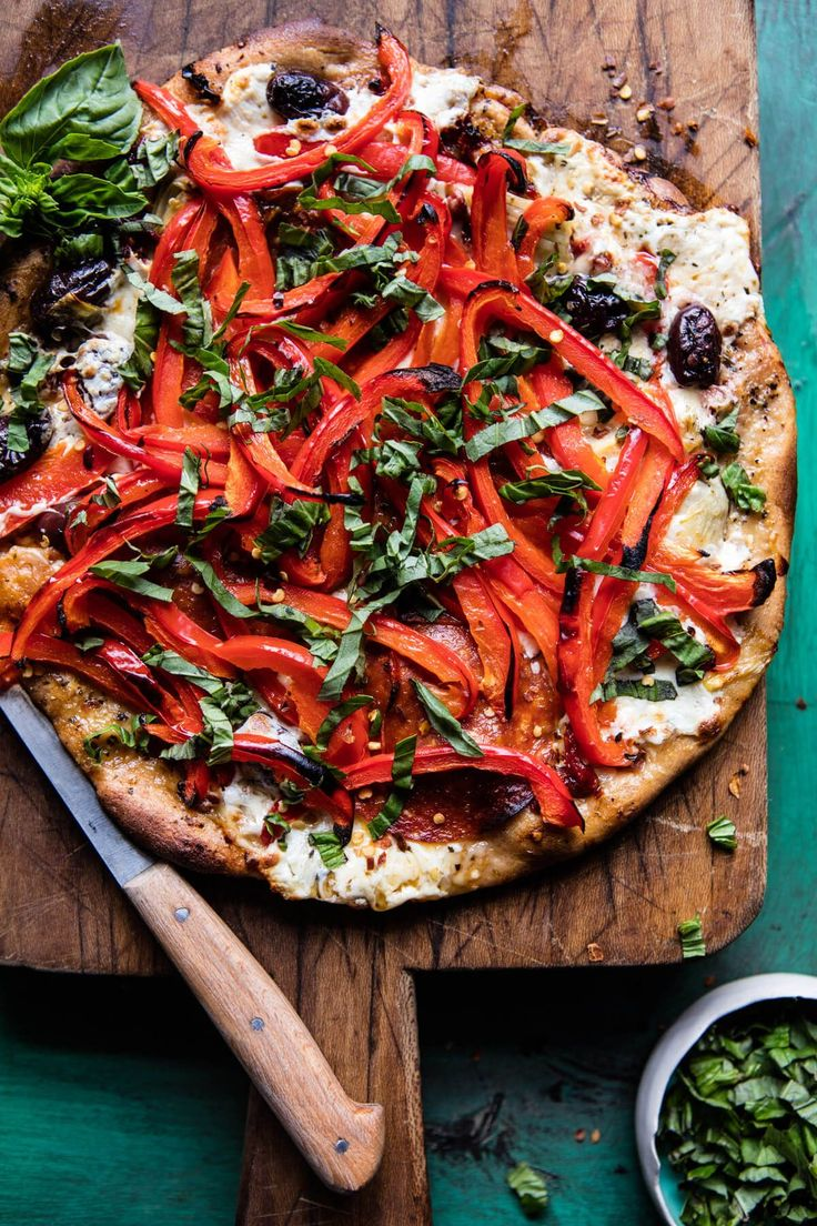 Mediterranean Roasted Red Pepper Pizza - Whole wheat, topped with olive oil, protein packed mozzarella, and piled high with veggies. @ halfbakedharvest.com