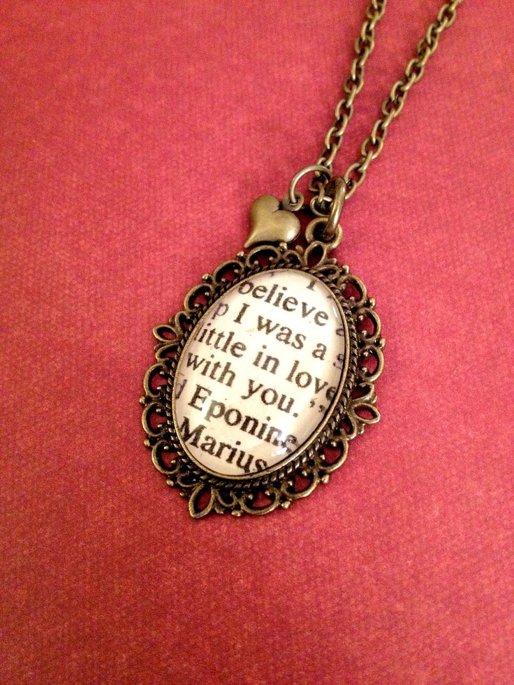 Jewelry from my favorite book: Eponine and Marius from Les Miserables Antique Bronze Book Page Necklace.  I must have this!!!!!!