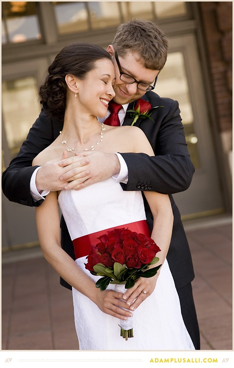 Wedding Pose. Red Sash. Red Roses. Sweet Moment.
