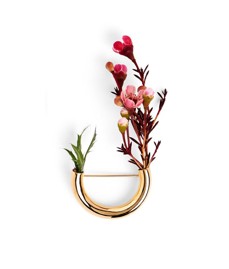The sleek Gold Lady Grey brooch comes filled with assorted silk flowers (not pictured) that can be replaced with fresh flowers or greens of your choice, and replaced over and over again. Soft branchy