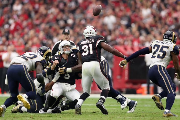 GLENDALE, AZ - OCTOBER 02: Quarterback Carson Palmer #3 of the Arizona Cardinals fumbles the football during the third quarter of the NFL game against the Los Angeles Rams at the University of Phoenix Stadium on October 2, 2016 in Glendale, Arizona. The Rams defeated the Cardinals 17-13.  (4225×2815)