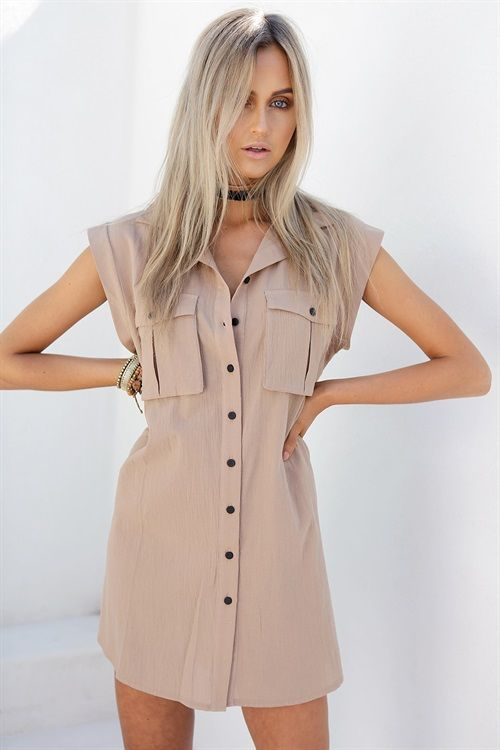 The Camel Shirt Dress is made from a lightweight raw fabric in a tan hue. It is a shift dress design and features a collar, twin pockets and black buttons up centre of dress. Complete the look with black boots and Black Plait Choker! Exclusively designed by Sabo Skirt.