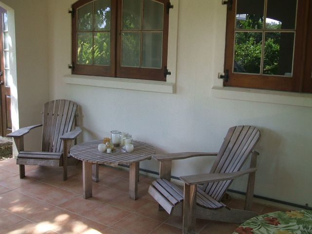 Come, sit, relax in peace and quiet on the covered porch.