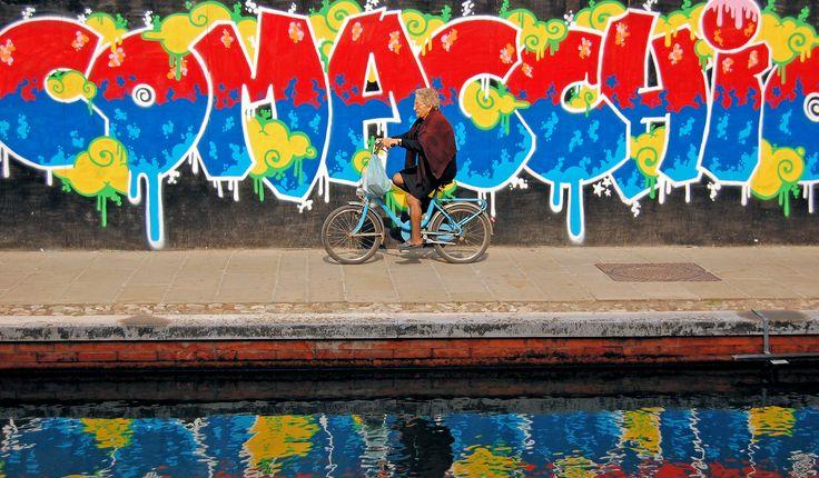 Street art and the old lady in Comacchio, Emilia-Romagna