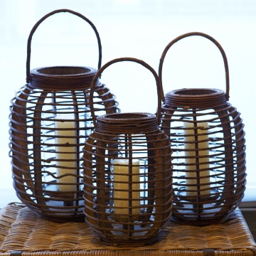 Ideal for both outdoor and indoor entertaining. These hand-woven rustic rattan pieces feature a glass hurricane and have an unpeeled natural finish. Woven from dark tropical vines, the rustic style compliments every occasion.