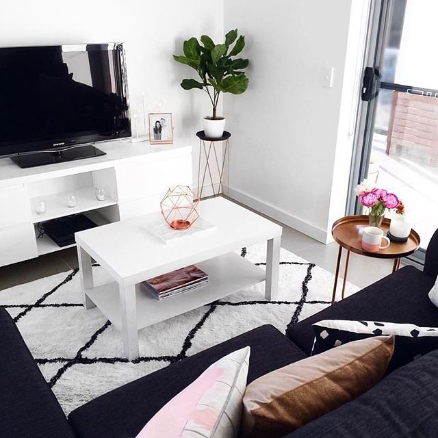 My living room ☁️ Featuring the Kmart fiddle leaf plant, copper geo candle holder, copper side table and pink mug
