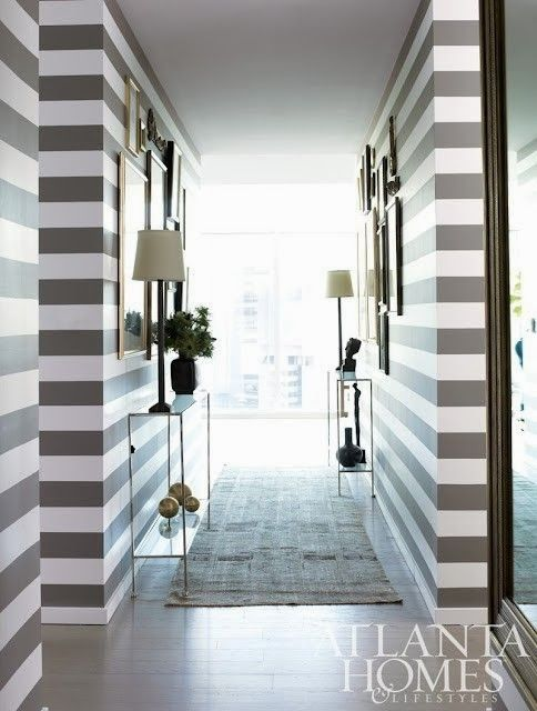 Hallway, stripes, skinny consoles, symmetry: