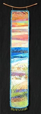 Longing for Sunset. Small landscape beach art quilt by Eileen Williams.