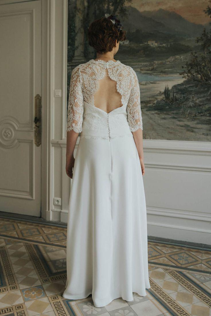Modèle Edith, robe de mariée à manche 3/4 en dentelle festonnée avec une encolure en coeur et un dos nu en losange semi transparent. Collection robes de mariee sur mesure 2018