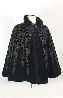 Beaded embroidered velvet cape, c.1895. This beautifully embellished cape can be displayed as part of your collection or worn with jeans. It is made from black velvet elaborately decorated with couched soutache and faceted black glass beads, whose subtle sparkle will delight all. The cape is lined with black taffeta and closes at the neckline with two large hooks that are original.
