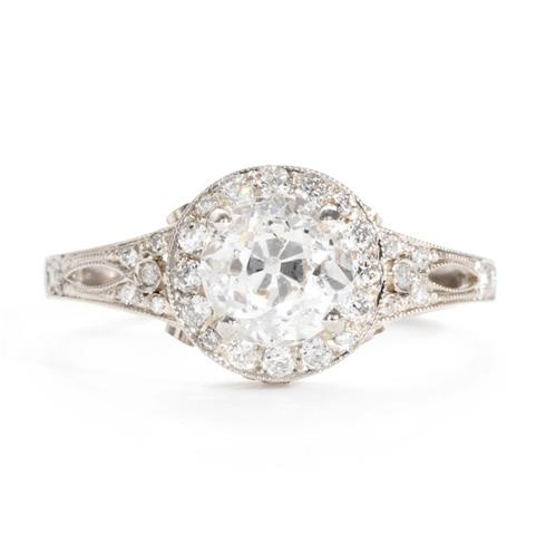 Handcrafted to uphold the authenticity of a vintage design, this enchanting engagement ring features an antique, old European cut diamond surrounded by a halo of pave diamonds and delicate milgrain and cutouts in the band.  Single Stone at Greenwich Jewelers, $9050