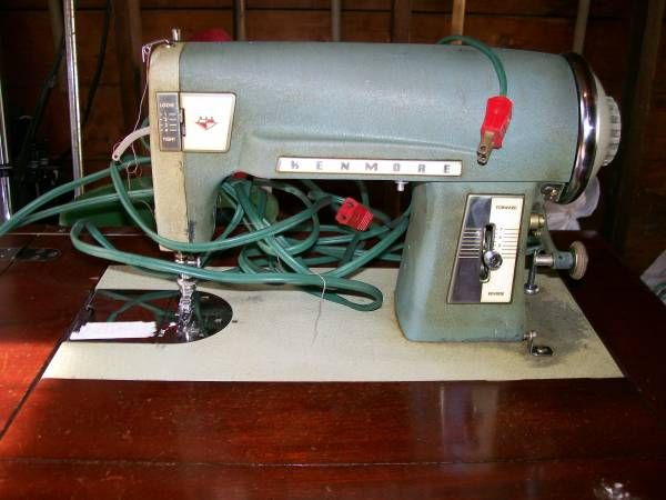 kenmore mini ultra sewing machine. kenmore 58 cabinet/table electric sewing machine. comes with owners manual and extra parts mini ultra machine