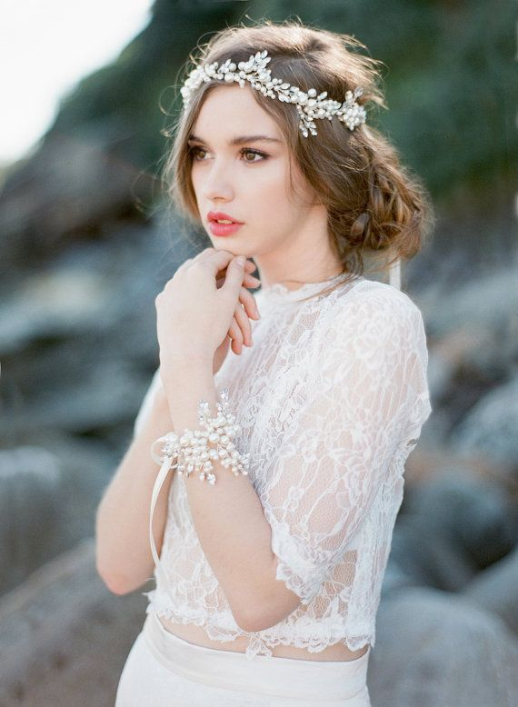 Exclusive to Bride La Boheme this gorgeous head piece is made with multiple ivory pearls wired with silver beads , all attached to an ivory double