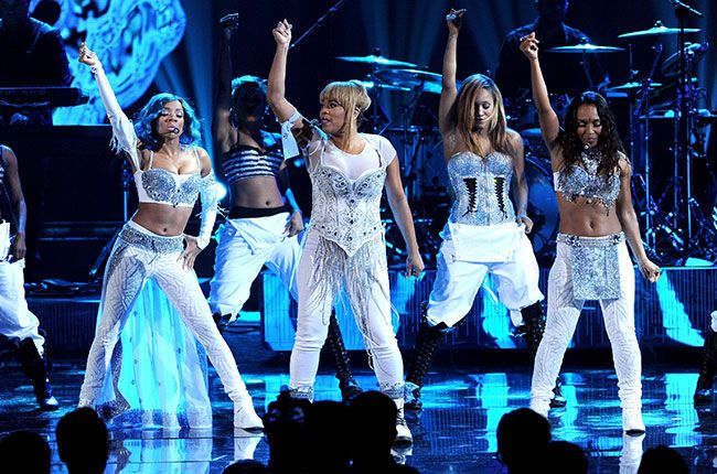 """Lil Mama performs with singers Tionne """"T-Boz"""" Watkins and Rozonda """"Chilli"""" Thomas of TLC onstage during the 2013 American Music Awards in Los Angeles, CA   Billboard"""