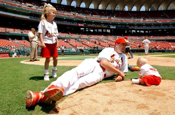 Saturday June 15, 2002-- St. Louis  Cardinals' pitcher Darryl Kile relaxes with 9-month-old son Ryker, right, and 5-year-old daughter Sierra watch Cardinal players take on their children in a father-child ball game in celebration of Fathers Day at Busch Stadium in St. Louis on Saturday June 15, 2002. Darryl Kyle was found dead in his Chicago hotel room on June 22, 2002 during a road trip.  RIP: St Louis, Stl Cardinal, Chicago Hotel, St. Louis Cardinals, Watch Cardinal, 5 Year Old Daughter, Cardinal Players