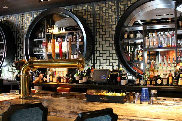Keyhole back of bar to showcase stemware and bottles.