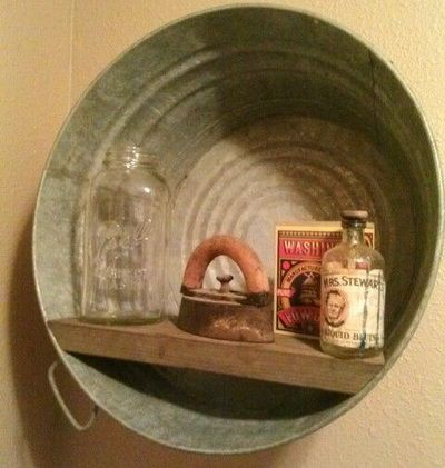 Recycled Metal Projects - wash tub made into a picture shelf frame