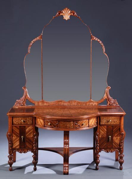 A Pennsylvania Furniture Co. (Early Pennsylvania House) bedroom set, with matching veneers, spider web veneered design, applied foliate scrolls, consisting of full size bed, vanity with mirror & bench, dresser with mirror, chest on chest and nightstand, c.1920s-30s, vanity:71.5h x 52.5w x 22d,