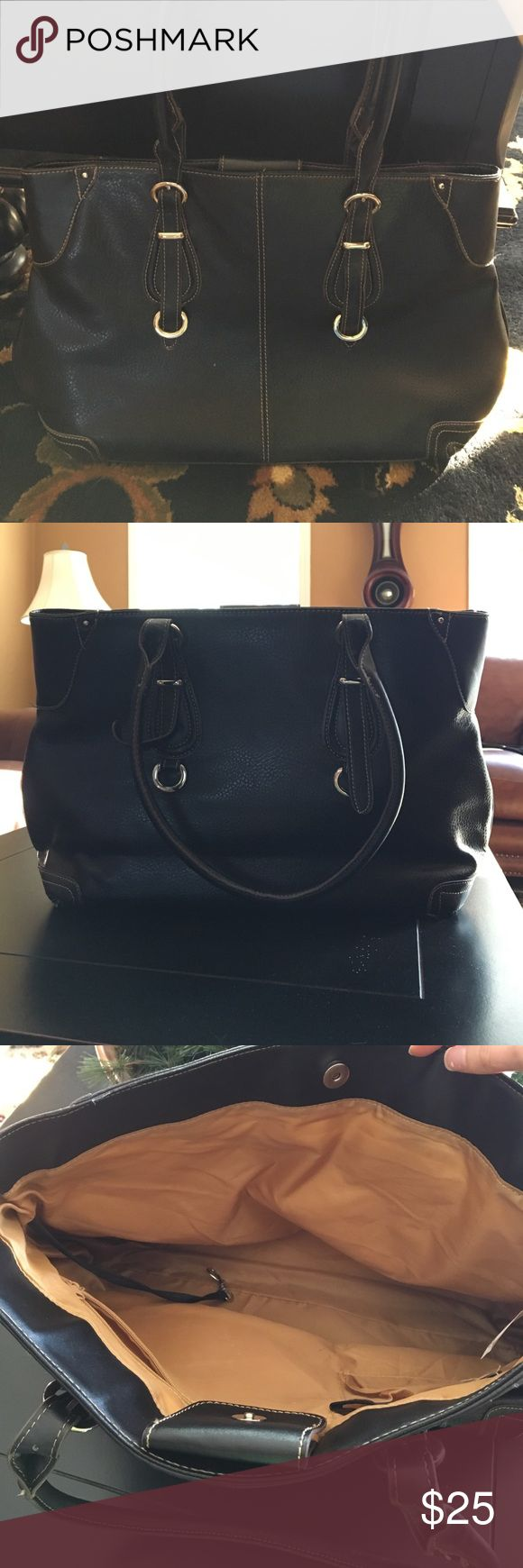 """Faux Leather Handbag Super nice and lightly used handbag! One of the buckles is a little iffy, so the strap has been tied in a knot around it, which has made it a little bent out of shape. Dimensions: 20""""x 12"""". The interior is tan and very roomy. No exterior pockets or compartments, but there are two inside (including one large one that zips). Brand is unknown. Offers welcome! Bags Shoulder Bags"""
