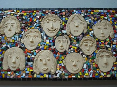 Great wet clay project turned wall mural! I would probably let the kids paint the faces, though, and leave the tiles all white.