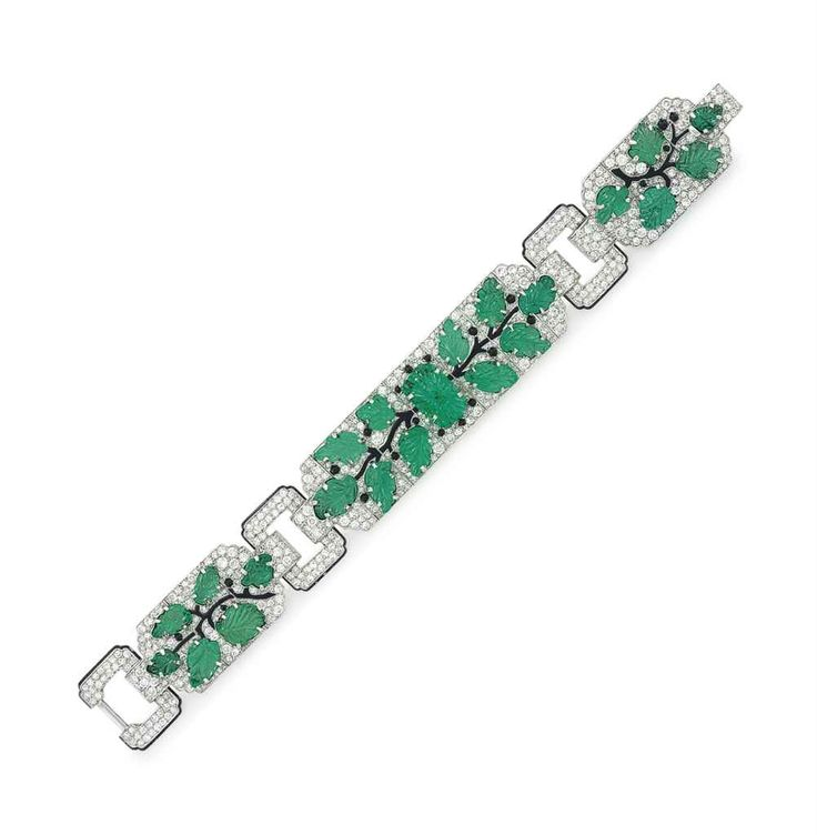 AN ART DECO DIAMOND, EMERALD, ENAMEL AND ONYX BRACELET, BY CARTIER Price realised  USD 751,500 Estimate USD 150,000 - USD 250,000