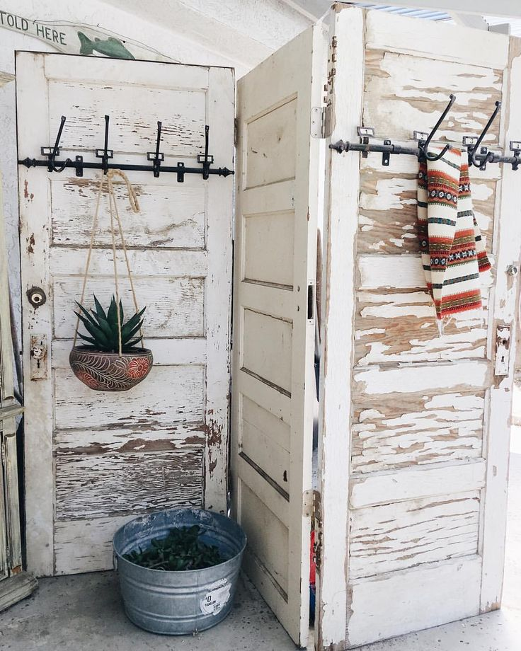 A few vintage doors and some hooks and you have yourself a patio divider