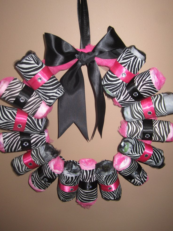 Zebra print diaper wreath see more zebra baby shower for Animal print baby shower decoration ideas