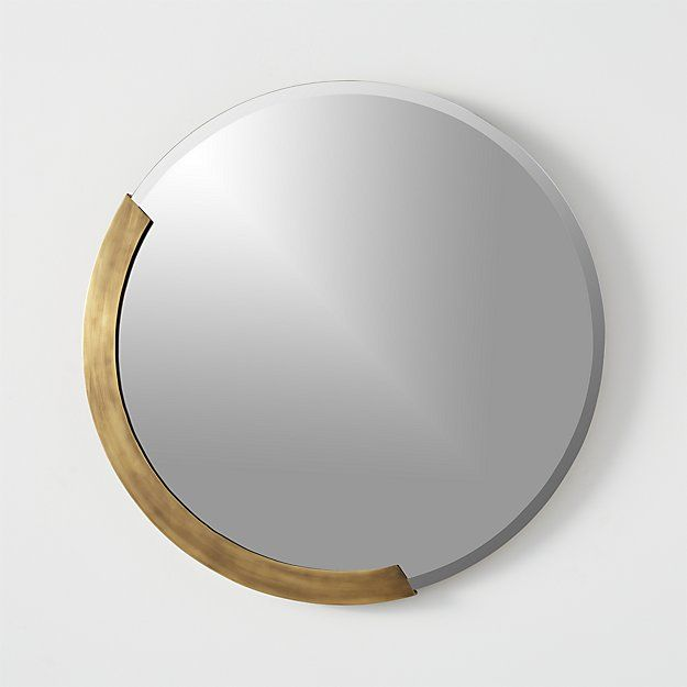 """Shop kit 24"""" round mirror.   Simple hand-beveled round reflects edgy glamour in a semi circle of antiqued brass.  Cool vintage store vibe is just the thing to add an upscale bit of personality."""