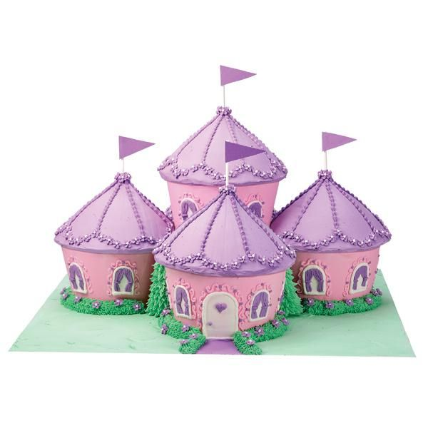 """""""Cupcake Kingdom Castle Cake""""   This fantastic magic fortress ideally suits every little princess. Build the royal compound from Dimensions® Giant Cupcake Pan cakes done up in pretty-in-pink-and-purple icings. Enjoy a magic show afterwards with Chad Wonder at http://www.idomagic.com"""