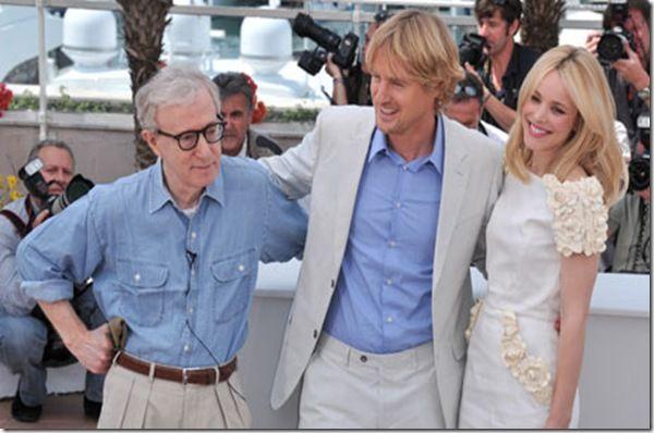 Midnight in Paris script wrter Woody Allen hugging cast members Owen Wilson and Rachel McAdams