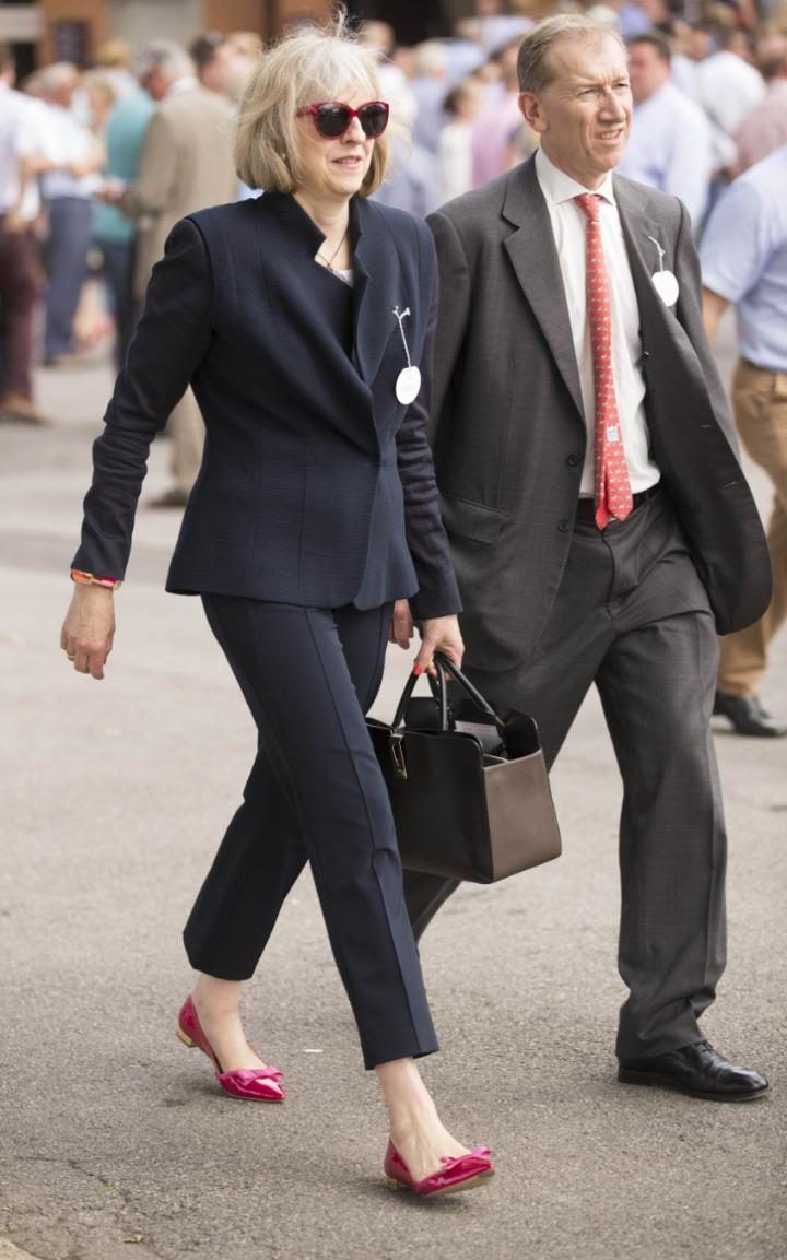 Theresa May in a sharp suit with the trouser cropped to the ankles…