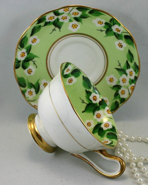 Vintage, Royal Albert Teacup & Saucer, Floral Pattern on Pale Green Background, Gold Rims, Bone English China made in 1960s. In good condition, no chips, cracks, crazing or repairs. The Saucer measures-5.5 (14cm) in diameter. The Cup opening-4 (10cm), with the handle-5 (12.5cm) The