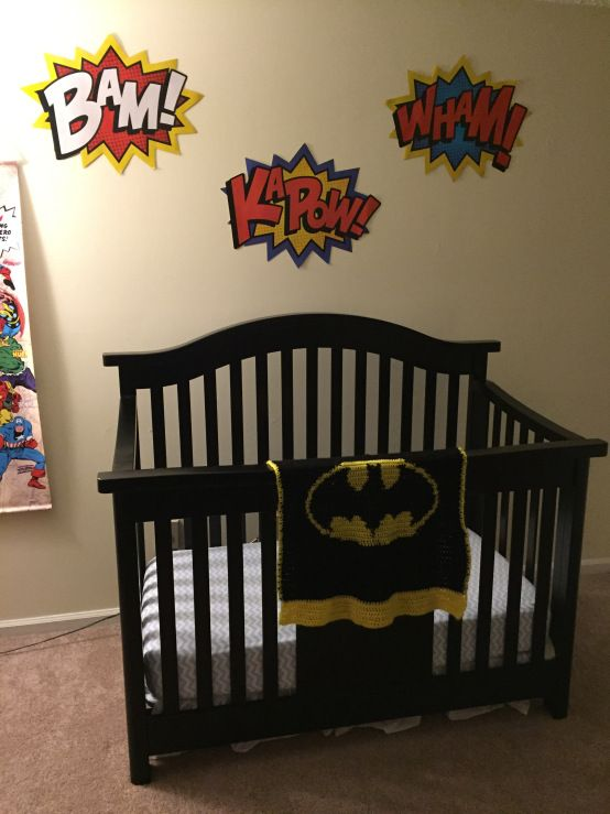 Superhero Nursery - comic book word cut outs above the crib