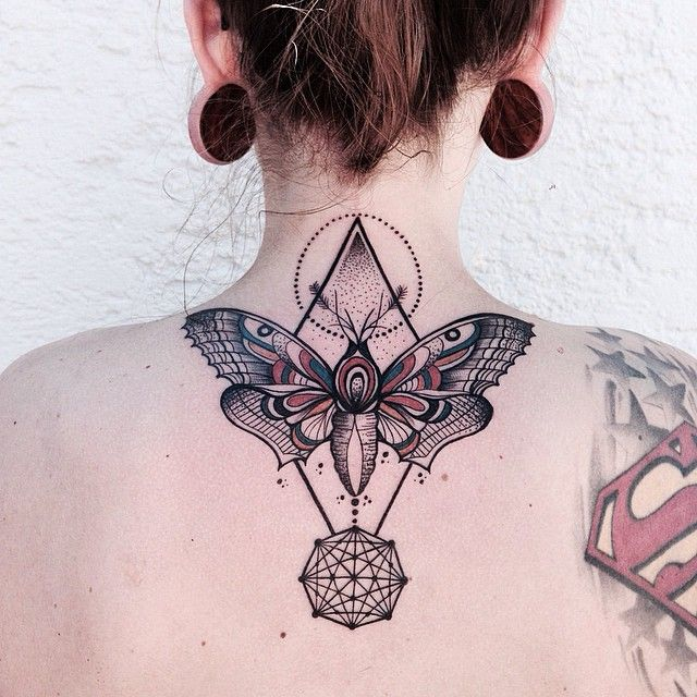 Butterfly and pyramid nape tattoo                                                                                                                                                                                 More