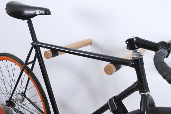 If sleek, clean and contemporary is your thing, then this is the storage solution for your bicycle. This wall mounted pair of hooks are made from eco ash