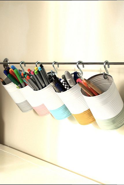 Hanging cans are a great way to store pens and pencils to clear up any desk space!