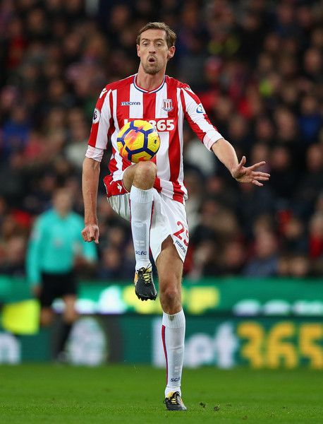 Peter Crouch of Stoke City in action during the Premier League match between Stoke City and Swansea City at Bet365 Stadium on December 2, 2017 in Stoke on Trent, England.