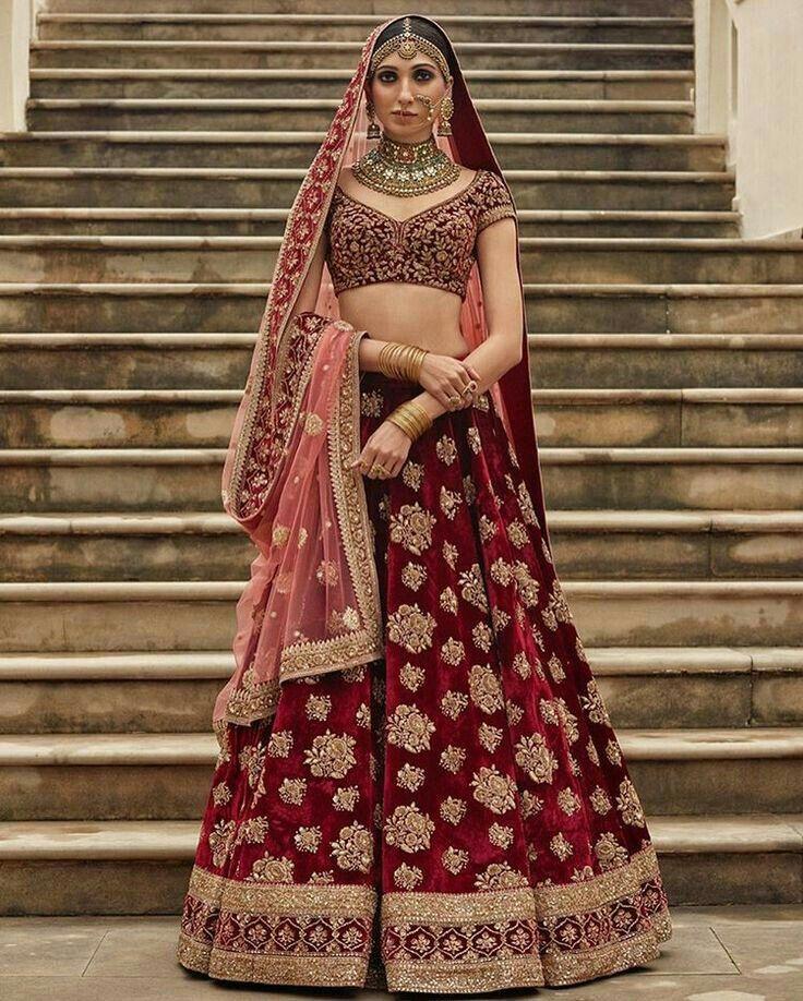 Red designer worked bridal lehnga...manish malhotra's design