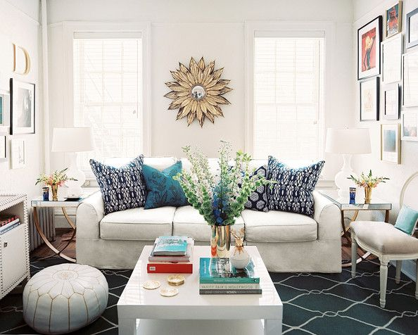 Living Room Photo A White Couch Coffee Table And Pouf Atop A Blue