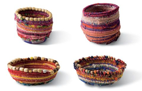 Basket 2008 by Yuwali Janice Nixon, Martumili Artists plant fibre and yarn on a metal base with bead trim 16 x 20 cm (diameter)  Basket 2008 by Yuwali Janice Nixon, Martumili Artists plant fibre and yarn on a metal base 20 x 19 cm (diameter)  Bottom row, left to right:  Basket 2008 by Yikartu Bumba, Martumili Artists plant fibre and yarn on a metal base with bead trim 8 x 23 cm (diameter)  Basket 2008 by Lily Long, Martumili Artists plant fibre and yarn on a metal base with bead trim 8 x 22…