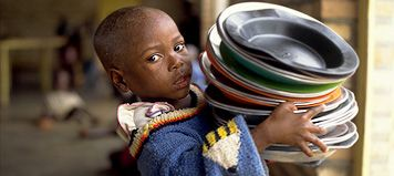 Goal: Eradicate extreme poverty and hunger  Targets by 2015:   Reduce by half the proportion of people living on less than a dollar a day.  Reduce by half the proportion of people who suffer from hunger.  Reducing poverty starts with children.