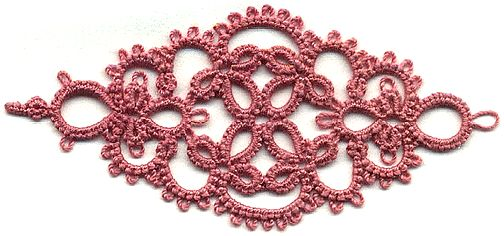 2 shuttles and split rings.  It's very cute used in a headband.