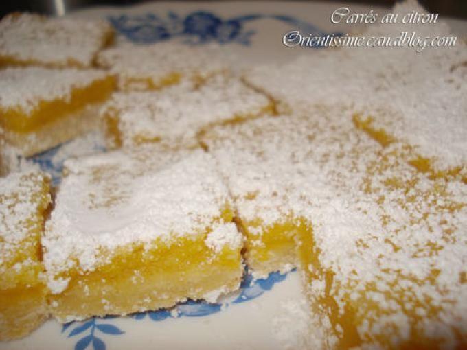 Une couche de crème délicieusement citronnée sur une base de biscuit sablée, ces carrés sont une véritable tuerie. - Recette Dessert : Carrés au citron: une tuerie !!!! par Humm... Orientissime!!!