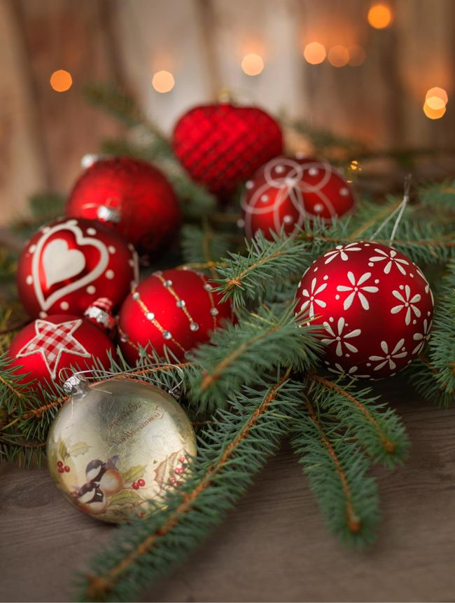 I like the decorations on these red Christmas  balls. Especially the red and white check star. Might try to make one some day.